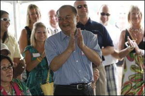 Dashing Pacific Group's Wu Kin Hung is introduced to the public during a ceremony at the Marina District in July, 2011. The company bought The Docks complex and more than half of the Marina District from the city of Toledo.