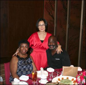 Ora Bell (left), Yuan Yuan Xiaohong center, and Mike Bell at dinner after arriving in Shenzhen, China.