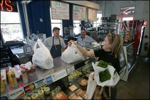 Susan Eskin shops at The Fish Guys store inside North Market, a more successful version of the Erie Street Market in Toledo.