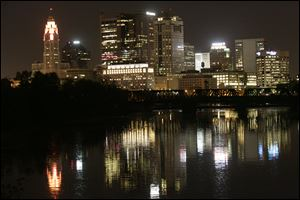 Columbus' skyline is bright at night, but most people have gone home from their day jobs.