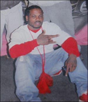 Lamar Allen, who died allegedly holding the Express Carryout store on Mulberry St. in Toledo.