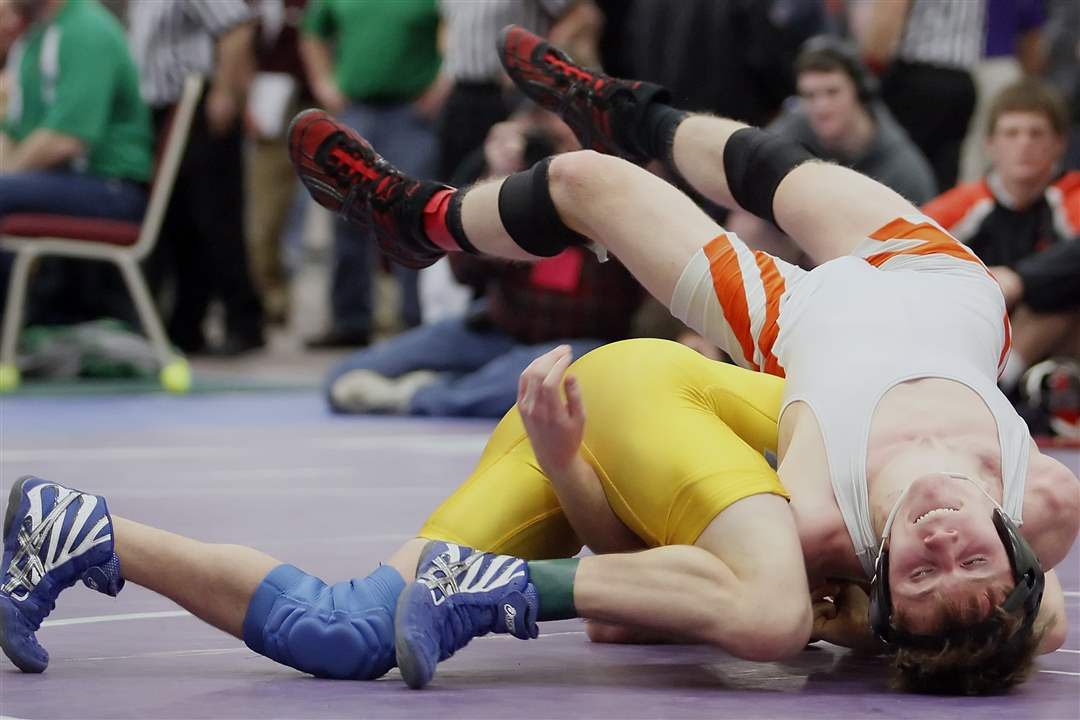 Cade-Mansfield-of-Ayersville-defeats-Damien-Showman-of-Seneca-East-12-3-in-the-120-pound-weight-class