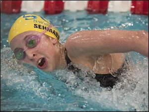 Emmy Sehmann of Toledo St. Ursula Academy swims a lap during the consolation round of the Women's 500-yard Freestyle event at the Ohio High School Div. I Swimming Championships in Canton, OH, Saturday, Feb. 25, 2012. Sehmann placed second in the race and 10th overall in the event.