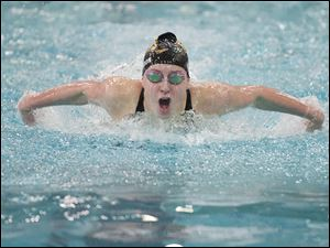 Karissa Gordon of Perrysburg High School swims the final leg of the Women's 100-yard Butterfly event at the Ohio High School Div. I Swimming Championships in Canton, OH, Saturday, Feb. 25, 2012. Gordon finished third in the race and placed 11th overall in the event.