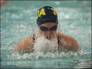 Rachael Dzierzak of Toledo Notre Dame Academy swims a leg of the Women's 100-yard Breaststroke event at the Ohio High School Div. I Swimming Championships in Canton, OH, Saturday, Feb. 25, 2012. Dzierzak placed third in the event.