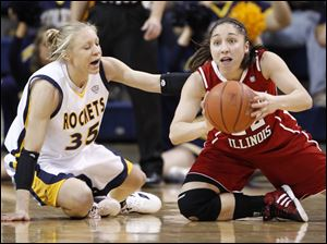 University of Toledo player Haylie Linn, 35, and Northern Illinois University player Amanda Corral, 22,  scramble for the loose ball during the second half at Savage Arena, Saturday, February 25, 2012.