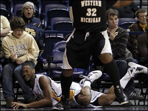 University of Toledo player Matt Smith, 43, runs into a fan during the first half against Western Michigan at Savage Arena, Saturday, February 25, 2012.