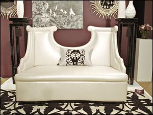A high sculpted-back settee in pearl finish from Priscilla Presley's home collection.