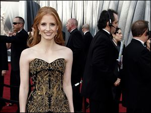 Jessica Chastain arrives before the 84th Academy Awards on Sunday, Feb. 26, 2012.
