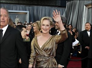 Meryl Streep greets the crowd upon arrival at the 84th Academy Awards.
