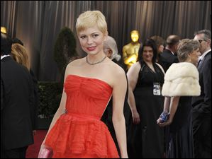 Michelle Williams arrives before the 84th Academy Awards on Sunday, Feb. 26, 2012.
