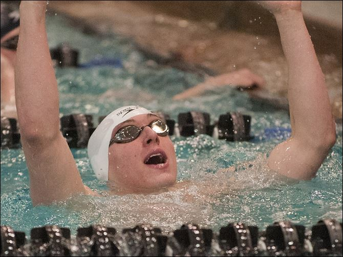 Dan DiSalle of St. Francis celebrates after winning the 50-yard freestyle at the Division I state swimming meet in Canton. DiSalle also captured the 100 free championship, helping the Knights to a third-place finish.