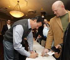 Republican-presidential-candidate-Rick-Santorum-signs-a-pamphlet
