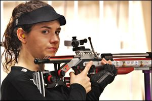 Sarah Scherer battled through a head cold to qualify for the U.S. Olympic team in the 10-meter air rifle.