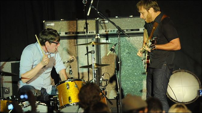 The Black Keys perform onstage at Chinatown's Historical Central Plaza in Los Angeles.