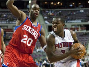 Detroit Pistons' Rodney Stuckey (3) drives against Philadelphia 76ers' Jodie Meeks (20) in the second half of an NBA basketball game, Tuesday, Feb. 28, 2012, in Auburn Hills, Mich. The 76ers defeated the Pistons 97-68. (AP Photo/Duane Burleson)