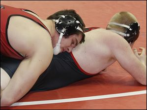 Zane Krall of Wauseon defeats Chase Henderson of Franklin during a Division II 220 pound preliminary match.