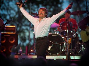 Davy Jones and the Monkees play in Lexington, Ky., on May 27, 2001. Jones, the heartthrob lead singer, died Wednesday of an apparent heart attack. He was 66.