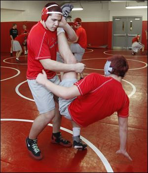 Bryan Smith (215 pounds) takes down Codie Bettencourt during practice. Smith finished in fifth place last year at state.
