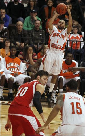 Bowling Green's Jordon Crawford shoots a 3-point shot that put the Falcons ahead 51-49 with about two minutes left in Wednesday's game against Miami. BG improved to 16-13, 9-6 in the MAC.