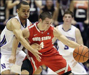 Ohio State's Aaron Craft controls the ball as Northwestern's Reggie Hearn defends. OSU needs to beat Michigan State to share the Big Ten title.