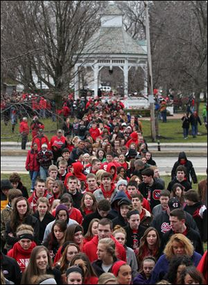 Chardon High School students, along with parents and supporters, march from the town square to the school. The 'walk-through' let students re-enter the buildings for the first time since the shootings. Regular classes are scheduled for all grades Friday.