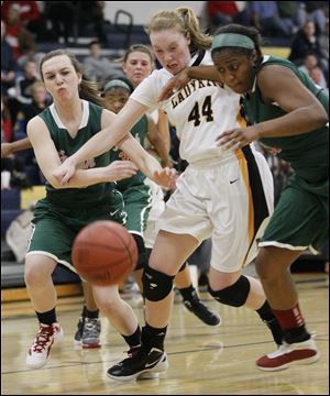 Northview's Maddie Cole (44) battles for a loose ball with Central Catholic's Michelle Murnen (33) and Sydni Harmon. Northview is now 21-1 on the season, while the Irish finish the year at 13-9.