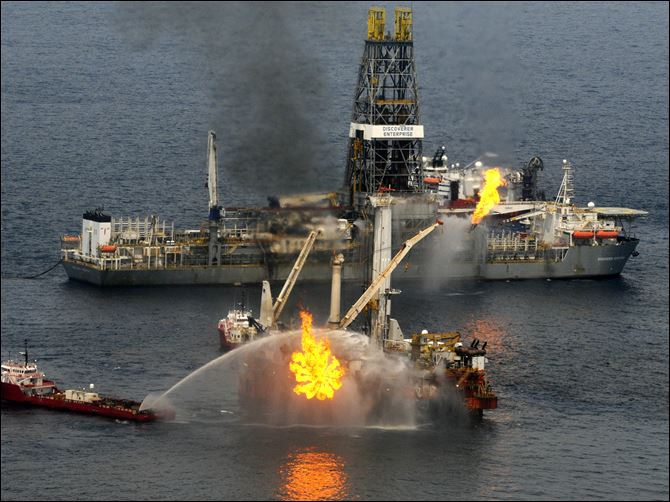 Gulf oil spill 2010 A rig burns oil and gas near the Discoverer Enterprise, background, at the site of the Deepwater Horizon oil spill in the Gulf of Mexico off the coast of Louisiana Saturday, June 19, 2010.