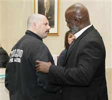 Mayor-Mike-Bell-talks-with-Toledo-fire-Lt-Matt-Tabb-before-a-news-conference-Friday
