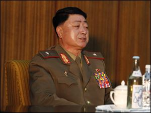 Kwak Chol Hui, deputy director of North Korea's National Defense Commission, attends a news conference Saturday in Pyongyang to discuss joint U.S.-South Korean war games that North Korea says threatens regional peace and stability.