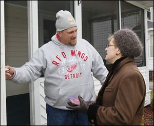 Point Place resident Scott Billock, left, and U.S. Rep. Marcy Kaptur.  U.S. Rep. Marcy Kaptur campaigns in the Point Place section of Toledo as she goes door-to-door for the newly created 9th Congressional District in Toledo, Ohio on Saturday.