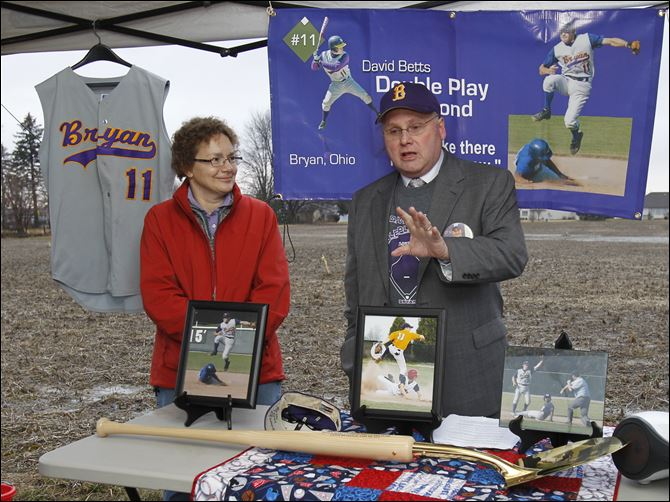 Memorabilia of David Betts Memorabilia of David Betts provide a setting for David's parents, Joy and John Betts, as Mr. Betts gives details before the groundbreaking of a new indoor baseball/softball venue in Bryan.