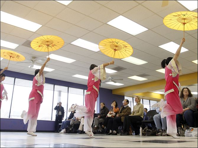 Members of the Toledo Academy of Tai Chi and Martial Arts, above, put on a display of Chinese folk dancing Saturday during  an open house in their quarters at 4444 Heatherdowns Blvd. in South Toledo.