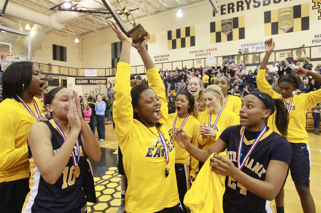 Notre-Dame-s-Talajha-Parker-raises-the-girls-Division-I-district-basketball-championship-trophy