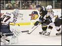 Cincinnati Cyclones goalie Chet Pickard stops a shot by Toledo Walleye left winger Andrej Nestrasil (11) during the first period.  Also in on the play in Cincinnati's Nick Tabisz (2).
