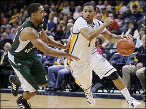 Toledo's Dominique Buckley drives against Eastern Michigan's Antonio Green during the second half of their men's basketball game at Savage Arena, Saturday.