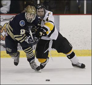 Northview's Kyler Omey, right, and Austin Kelly of St. John's battle for the puck during the district final on Saturday night.