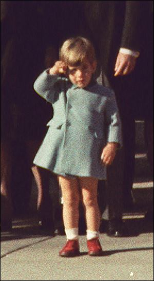 John F. Kennedy, Jr., salutes his father's coffin at the Cathedral of St. Matthew.