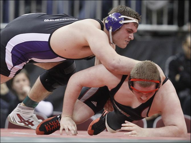Lytle repeats Mimmo Lytle, left, of Swanton controls Nino Majoy of Huron in the Division III 285-pound final Saturday at Value City Arena in Columbus. Lytle won 1-0 to take his second straight state championship.