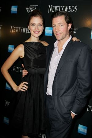 Caitlin Fitzgerald and Edward Burns arrive at the New York premiere of 'Newlyweds.' Burns wrote, directed, and starred in the film with Fitzgerald.