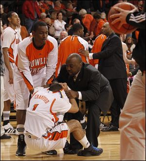 BG's Jordon Crawford is consoled by Craig Sealey and Central Michigan assistant coach Terrance Chatman. Crawford missed a free throw with 2.7 seconds left.