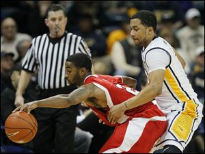 University of Toledo guard Dominique Buckley (1) defends against  Miami guard Quinten Rollins (2).