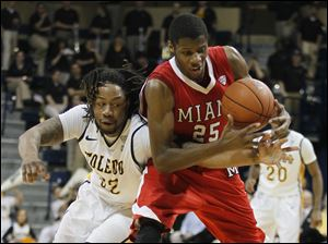 University of Toledo forward Reese Holiday (32) battles  Miami forward Jon Harris (25) for the ball.