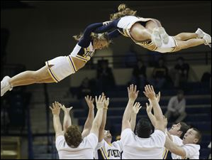 University of Toledo cheerleaders perform during the  first round of the MAC tournament Monday.
