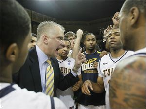 University of Toledo head coach Tod Kowalczyk talks to his team after they defeated Miami in the first round of the MAC tournament..
