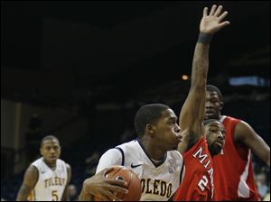 University of Toledo guard Julius Brown (20) looks for an opening against Miami guard Quinten Rollins (2).