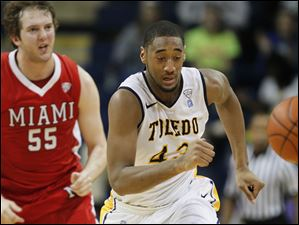 University of Toledo forward Matt Smith (43) steals the ball from Miami's Vince Legarza (55).