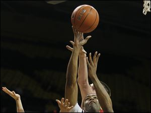 University of Toledo guard Curtis Dennis (33) goes to the net against Miami guard Will Sullivan (13).