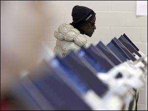 Michele Grinter casts her vote at Sherman Elementary School, Tuesday.