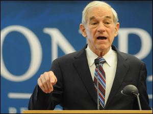 Republican presidential candidate Rep. Ron Paul, R-Texas, addresses a gathering of supporters at a rally in Nampa, Idaho.